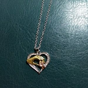Jewelry - Mother and child hands in heart shaped necklace nw